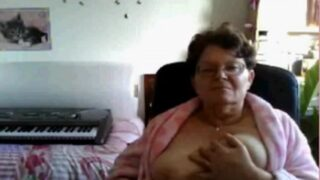 Horny granny shows tits on webcam